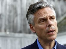 Possible 2012 presidential hopeful and former Republican Gov. Jon Huntsman Jr., of Utah, speaks to a reporter at a gathering at the home of Nancy and Wally Stickney in Salem, N.H., on June 10, 2011. (Associated Press)