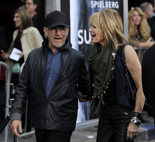"""Steven Spielberg, producer of the film """"Super 8,"""" arrives with his wife, actress Kate Capshaw, at the premiere of the film in Los Angeles on June 8, 2011. (Associated Press)"""
