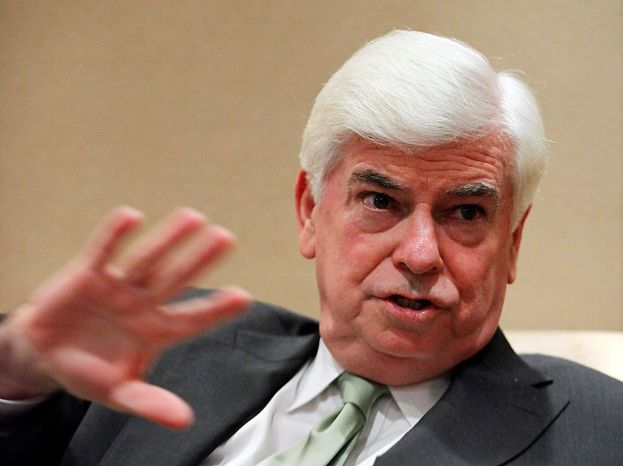 "ASSOCIATED PRESS ""It would be ridiculous for me to be here and not mention them (Hollywood's concerns). It would be just as ridiculous for me to get up at the Shanghai Film Festival and use it as a forum to raise my voice loudly about them,"" said Chris Dodd, new chief executive of"