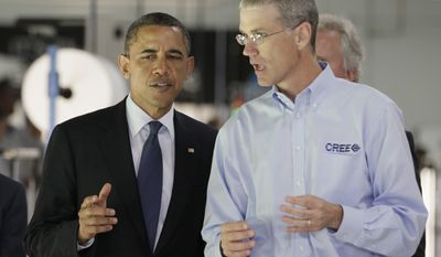 President Obama tours the manufacturing facilities of Cree, a leading manufacturer of energy-efficient LED lighting, with Chuck Swoboda, the company's president and chief executive officer, on June 13, 2011, in Durham, N.C. (Associated Press)
