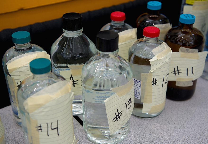 Bottles of unmarked water wait to be tasted in the 2011 Best of the Best water taste test on Tuesday at the Washington Convention Center. (Barbara L. Salisbury/The Washington Times)
