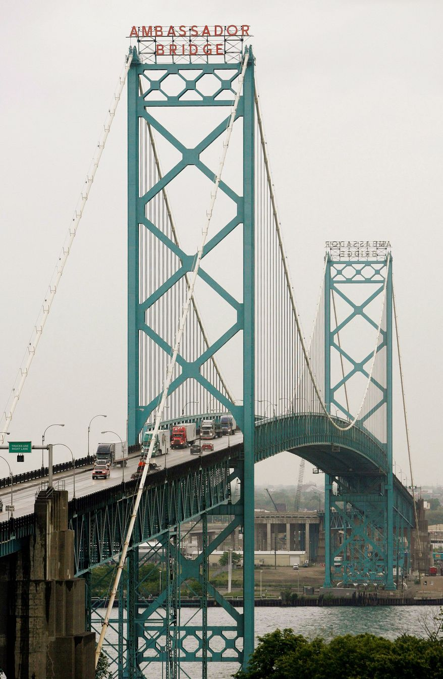 Thousands of commercial vehicles cross the Ambassador Bridge, as viewed from Windsor, Ontario, every day. (Associated Press)