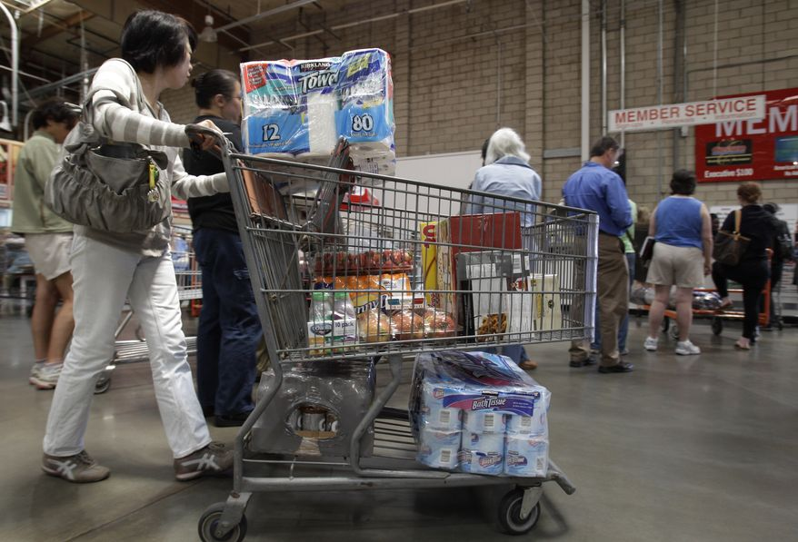 A shopper gets in the checkout line at a Costco in Mountain View, Calif., on Monday, June 13, 2011. Wholesale prices rose at the slowest pace in 10 months in May as food costs fell and gas prices rose by the smallest amount in eight months. (AP Photo/Paul Sakuma)