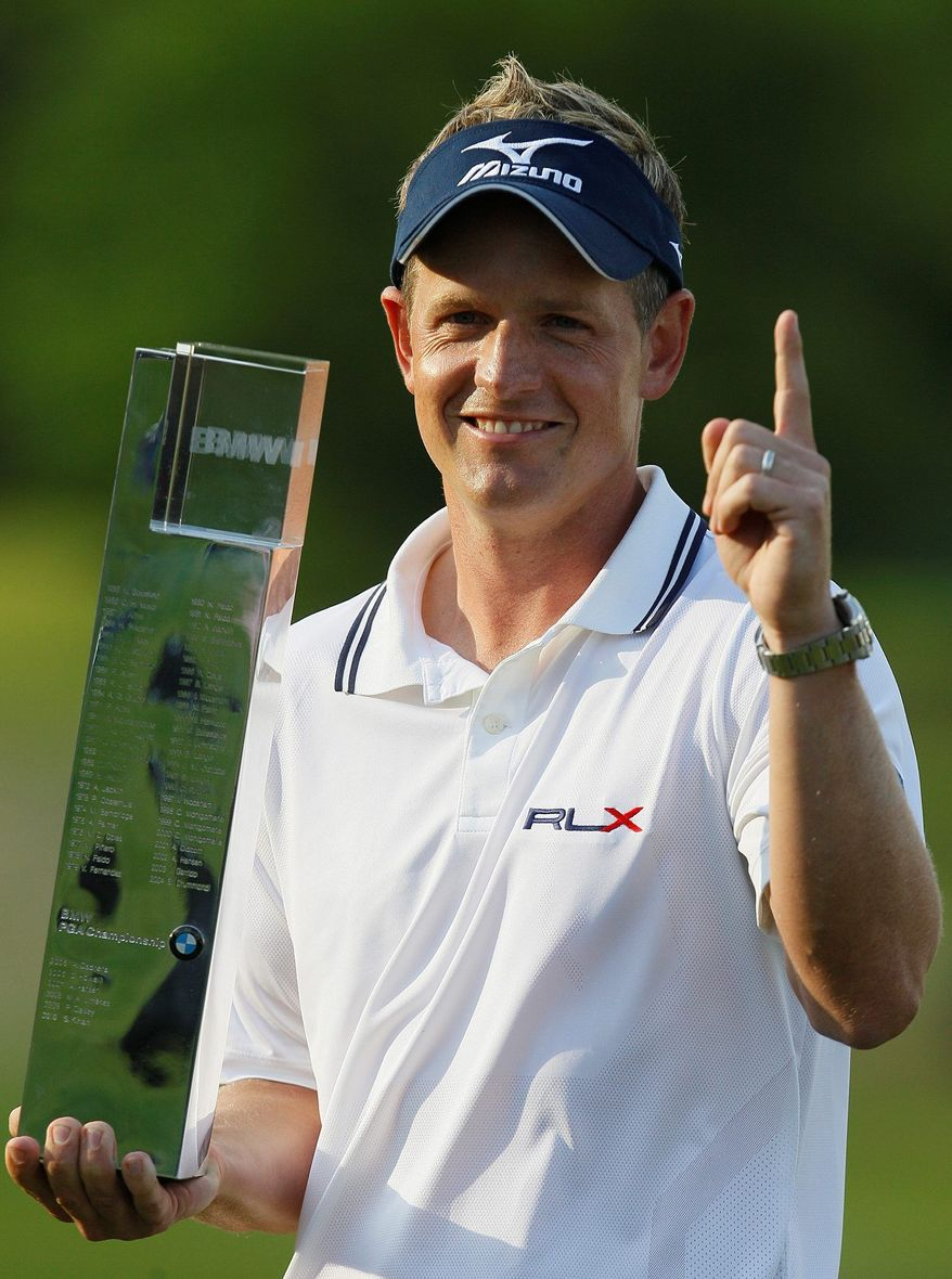 ASSOCIATED PRESS Luke Donald celebrates with the European PGA trophy after winning the tournament in Wentsworth, England. The victory May 29 made him the world's top-ranked golfer.