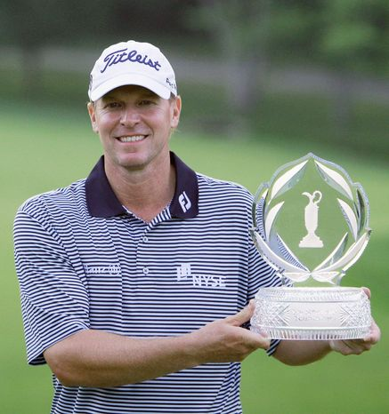 Steve Sticker holds up the trophy after winning the Memorial golf tournament at the Muirfield Village Golf Club in Dublin, Ohio, Sunday, June 5, 2011. Stricker finished at 16-under par for the tournament. (AP Photo/Tony Dejak)