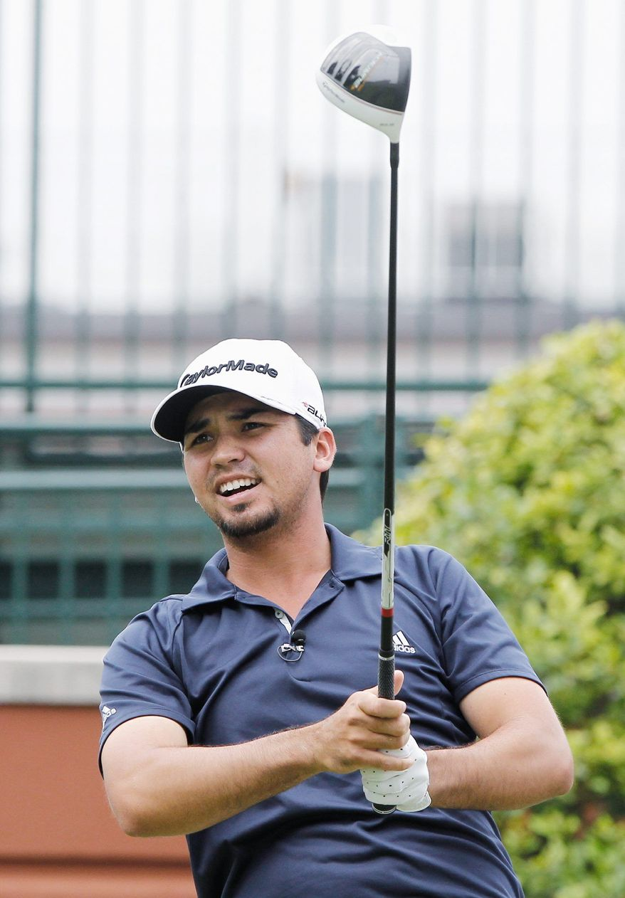 Jason Day watches his tee shot in the first round at the Crowne Plaza Invitational at Colonial golf tournament Thursday, May 19, 2011. (AP Photo/ Richard W. Rodriguez)