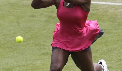 U.S.'s Serena Williams plays a return to Russia's Vera Zvonareva during their second round single tennis match at the Eastbourne International grass court tournament in Eastbourne, England, Wednesday, June 15, 2011. (AP Photo/Sang Tan)