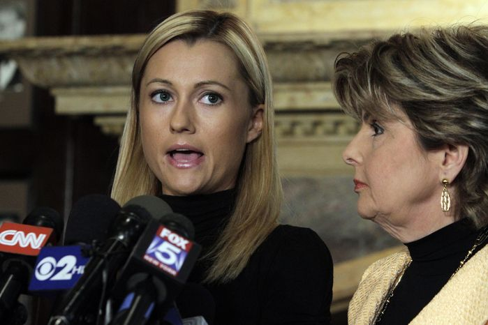 Former porn actress Ginger Lee (left) reads a prepared statement as her lawyer, Gloria Allred, looks on during a news conference at the Friars Club in New York on Wednesday, June 15, 2011. Ms. Lee, who said she had exchanged emails and messages over Twitter with Rep. Anthony D. Weiner, said he asked her to lie about their online communications. (AP Photo/Richard Drew)