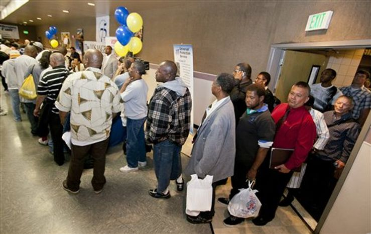 Job seekers line up at the 10th annual Skid Row Career Fair held at the Los Angeles Mission downtown Los Angeles Thursday, June 2, 2011. Employers hired only 54,000 new workers in May, the fewest in eight months, and the unemployment rate rose to 9.1 percent. (AP Photo/Damian Dovarganes)