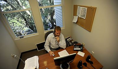 Account Manager/Recruiter Jack L. Beabout with Dunhill Staffing Systems,  discusses the positive influence that Boeing brings to the Charleston, SC. community on June 16, 2011 at his office in Mount Pleasant, SC. Dunhill Staffing Systems is a recruiting firm that places professionals with companies for jobs. Boeing is one of those companies. (Jeremy Lock/Special to The Washington Times)