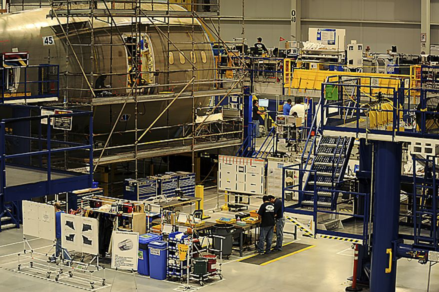 Boeing employee's work in the 787 Dreamliners Aft Body Assembly building on June 16, 2011 in Charleston, SC. The new Final Assembly Building  will be home to the second 787 Dreamliner final assembly and delivery facility. The building is the size of 10.5 football fields and can house two 787 Dreamliners wingtip to wingtip. Boeing will be able to deliver three airplanes per month. (Jeremy Lock/Special to The Washington Times)