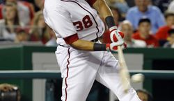 Washington Nationals slugger Michael Morse has signed a multiyear extension with the team. He batted .303 with 31 home runs and 95 RBI last season. (AP Photo/Ann Heisenfelt)