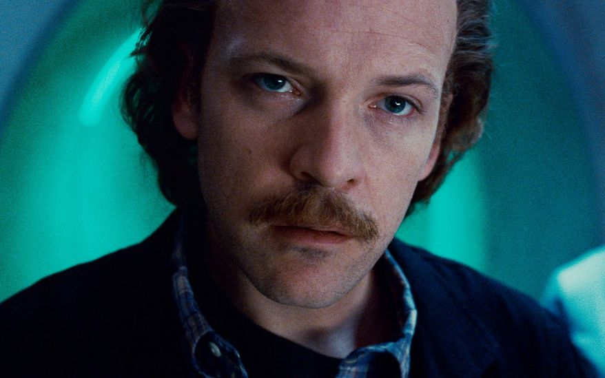 "Peter Sarsgaard plays Dr. Hector Hammond, who becomes infected by fear-fueled yellow energy in ""Green Lantern."" (Associated Press)"