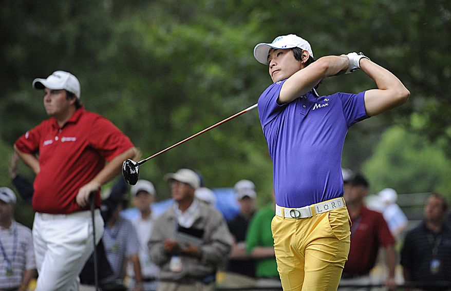 Dae Hyun Kim, of South Korea, tees off on the first hole to open the first round of the U.S. Open at Congressional Country Club in Bethesda, Md., Thursday, June 16, 2011. (Rod Lamkey, Jr./The Washington Times)