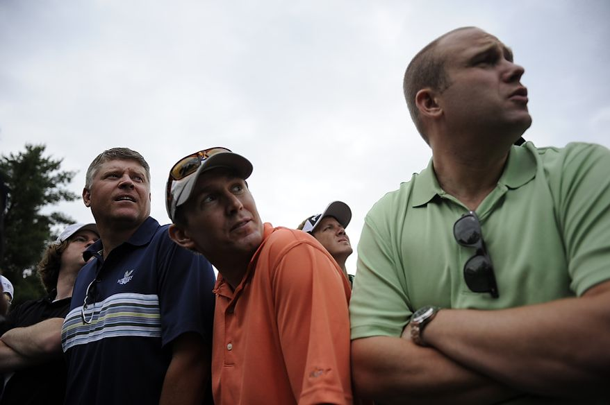 Spectators watch Luke Donald tee off on the 13th hole during the first round of the U.S. Open at Congressional Country Club in Bethesda, Md., Thursday, June 16, 2011. (Drew Angerer/The Washington Times)