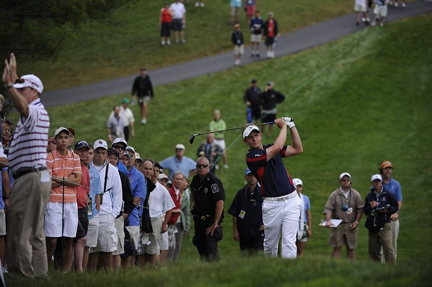 Luke Donald, of England, hits a fairway shot on the 13th hole during the first round of the U.S. Open at Congressional Country Club in Bethesda, Md., Thursday, June 16, 2011. (Drew Angerer/The Washington Times)