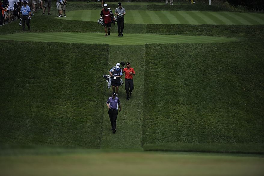 Jason Day walks down a fairway during the first round of the U.S. Open at Congressional Country Club in Bethesda, Md., Thursday, June 16, 2011. (Drew Angerer/The Washington Times)