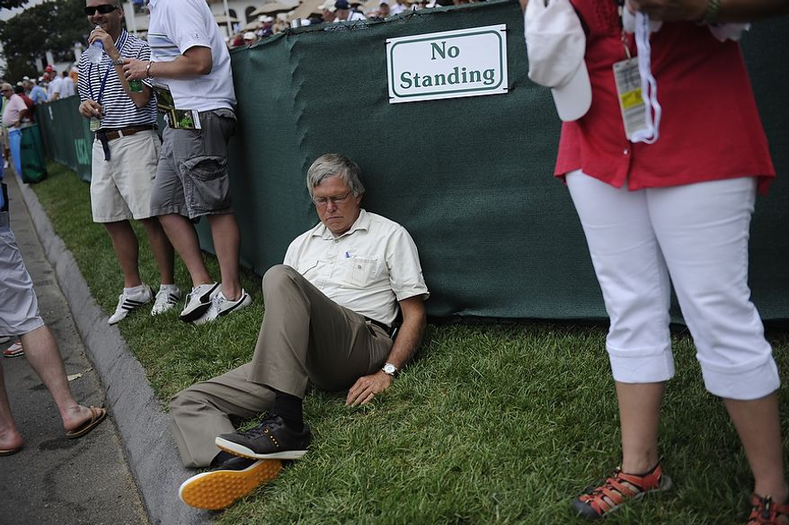 A spectator takes a nap during the first round of the U.S. Open at Congressional Country Club in Bethesda, Md., Thursday, June 16, 2011. (Drew Angerer/The Washington Times)