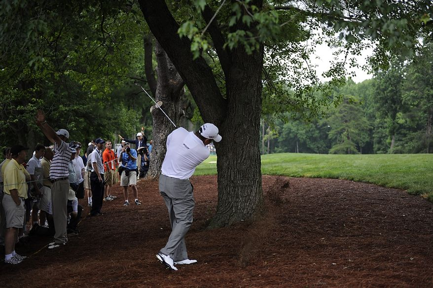 Lee Westwood, of England, hits around a tree on the 12th hole during the first round of the U.S. Open at Congressional Country Club in Bethesda, Md., Thursday, June 16, 2011. (Drew Angerer/The Washington Times)