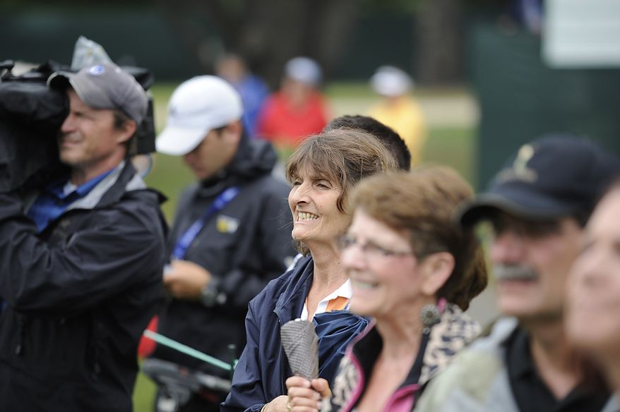Joan Tobiason watches her son Michael Tobiason, Jr., of Wilmington, Del. tee off on the first hole during the first round of the U.S. Open at Congressional Country Club in Bethesda, Md., Thursday, June 16, 2011. (Rod Lamkey, Jr./The Washington Times)