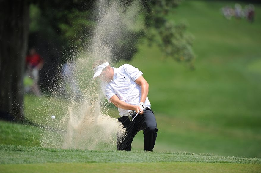 Jeff Overton tries to blast his way out of a bunker next to the 14th green during the first round of the U.S. Open at Congressional Country Club in Bethesda, Md., Thursday, June 16, 2011. (Rod Lamkey, Jr./The Washington Times)