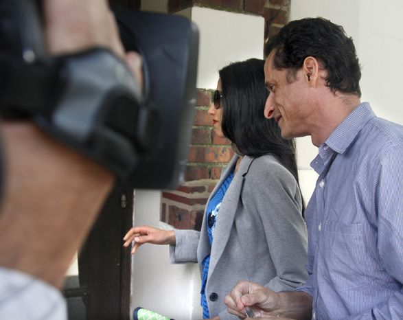Rep. Anthony D. Weiner and his wife, Huma Abedin, arrive at their home in the New York borough of Queens on Thursday, June 16, 2011, before he left for a press conference to announce his resignation from Congress.