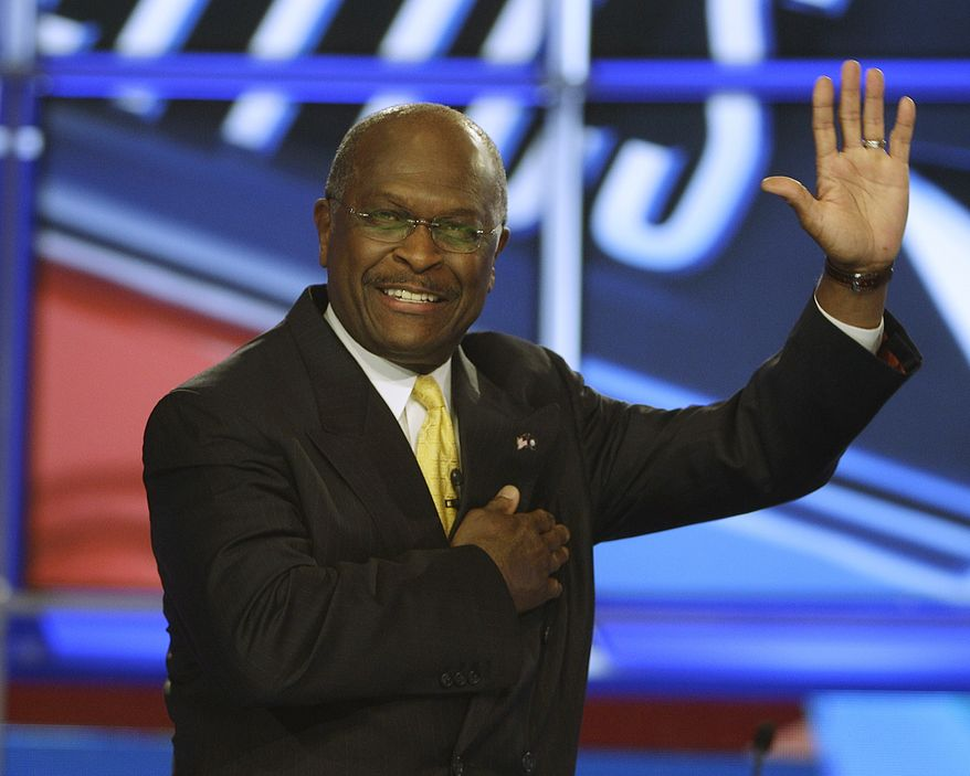 ** FILE ** Businessman Herman Cain waves as he takes the stage before the first New Hampshire Republican presidential debate at St. Anselm College in Manchester, N.H., Monday, June 13, 2011. (AP Photo/Stephan Savoia)