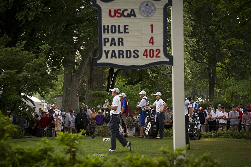 2011 Masters champion Charl Schwartzel watches his ball in flight as he tees off at the first hole during the second round of the 2011 U.S. Open Congressional, in Bethesda, Md., Friday, June 17, 2011, and the first day of competition. (Rod Lamkey Jr./The Washington Times)