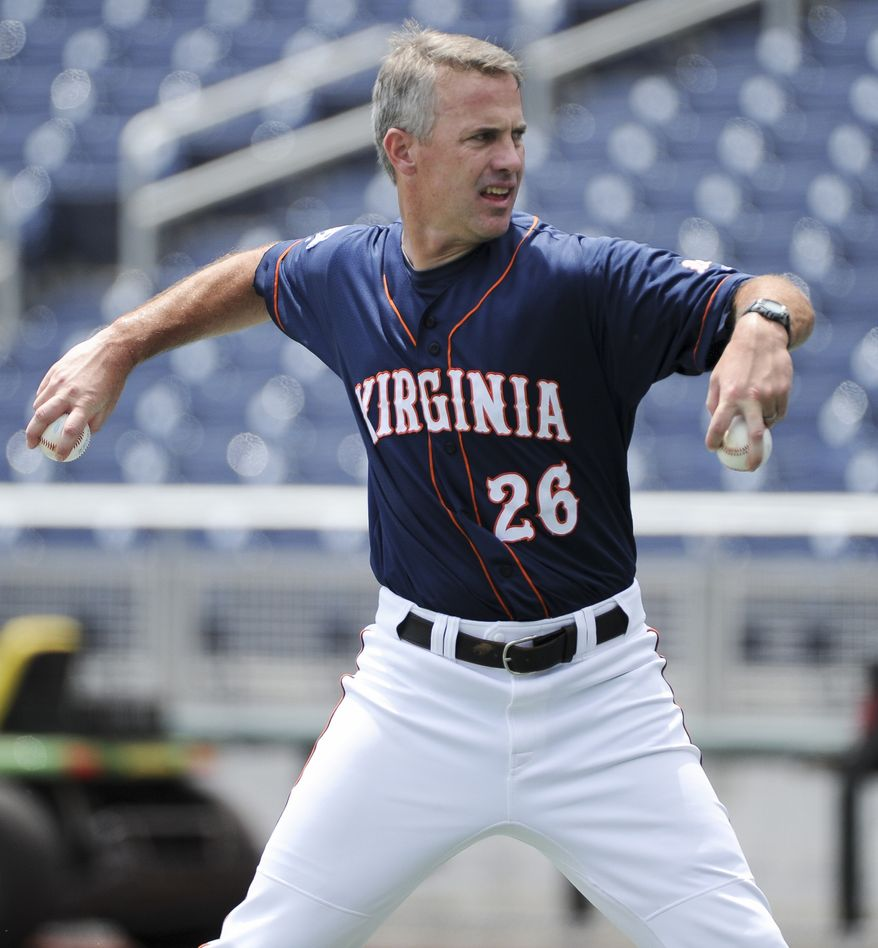 Virginia coach Brian O'Connor throws during team practice at TD Ameritrade Park in Omaha, Neb., Friday, June 17, 2011. Virginia plays California in the NCAA College World Series on Sunday. (AP Photo/Eric Francis)