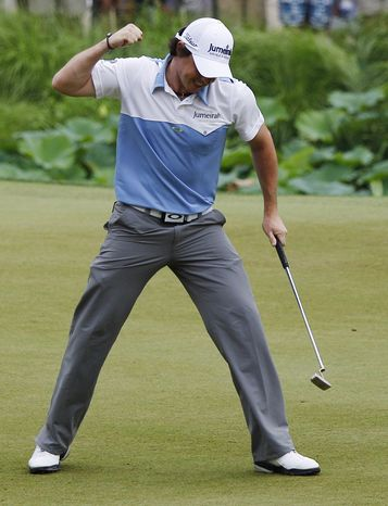 Rory McIlroy, of Northern Ireland, reacts after making his birdie putt on the 11th hole during the third round of the U.S. Open Championship golf tournament in Bethesda, Md., Saturday, June 18, 2011. (AP Photo/Matt Slocum)