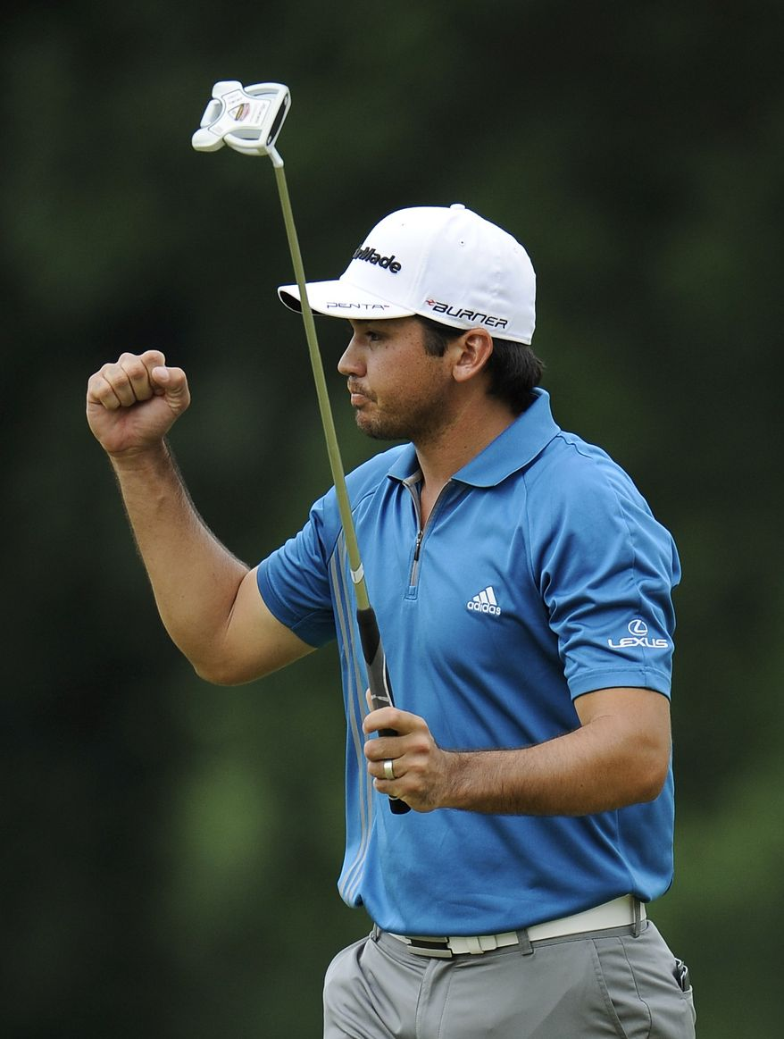 Jason Day, of Australia, reacts to his round as he walks off of the 18th green during the third round of the U.S. Open Championship golf tournament in Bethesda, Md., Saturday, June 18, 2011. (AP Photo/Nick Wass)