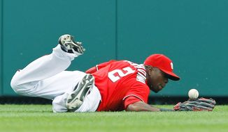 ASSOCIATED PRESS Nationals center fielder Roger Bernadina can't come up with a second-inning single by the Orioles' Derrek Lee, who below right collides with Nats second baseman Danny Espinosa. Lee went 9 for 13 in the three-game series, raising his average from .214 to .245.