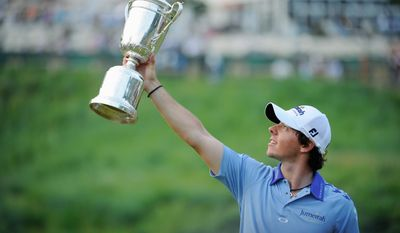 Northern Ireland's Rory McIlroy hoists the U.S. Open trophy at Congressional Country Club in Bethesda on Sunday, June 19, 2011, after running away from the field, finishing with a tournament best-ever 16 under par. (The Washington Times)