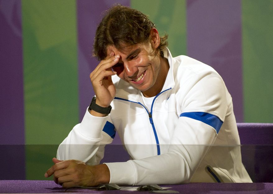 Spain's Rafael Nadal smiles during a press conference at the All England Lawn Tennis Championships at Wimbledon, Sunday, June 19, 2011. (AP Photo/AELTC,Tom Lovelock,Pool)