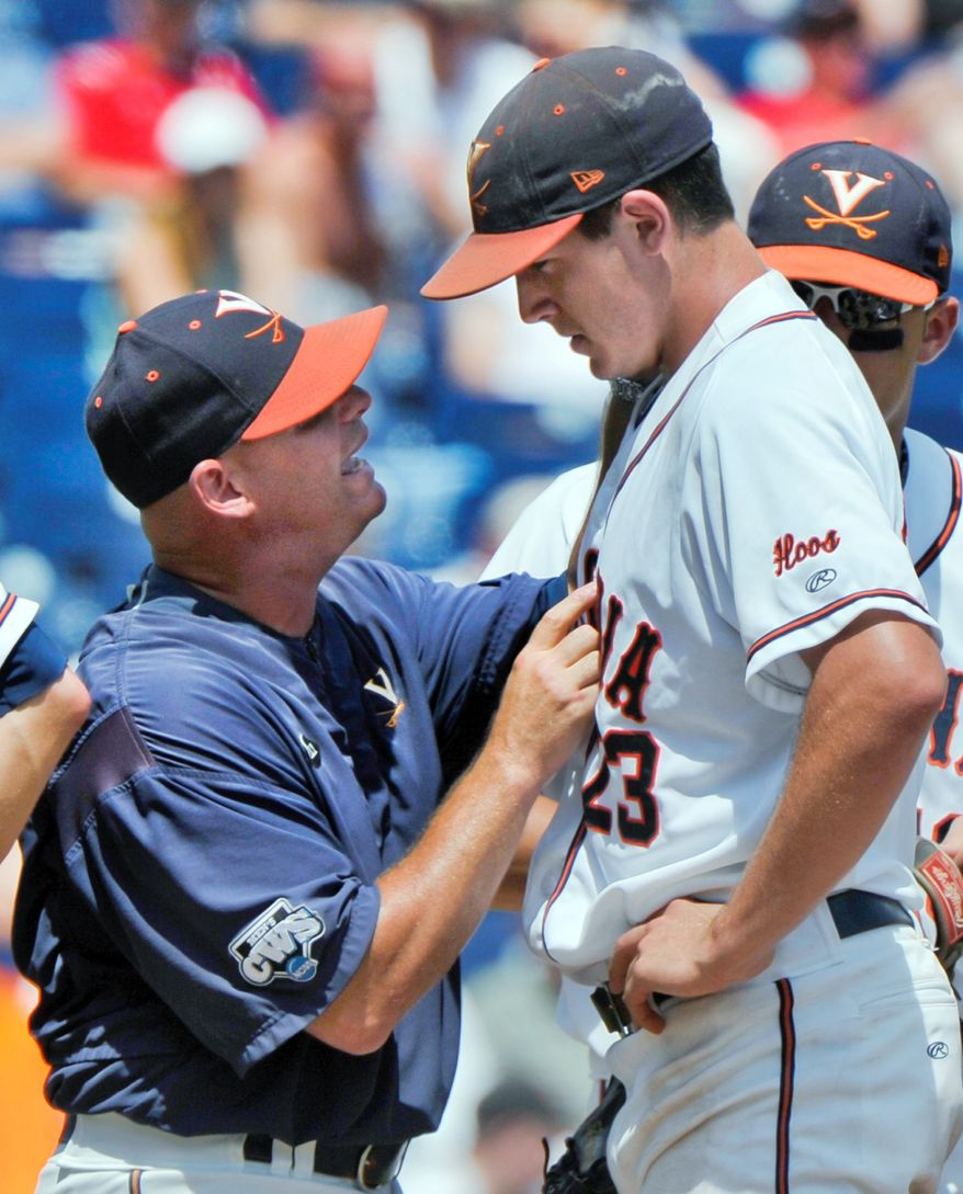 Virginia's assistant coach Karl Kuhn, left, talks to starting pitcher Danny Hultzen in the fifth inning of an NCAA College World Series baseball game against California in Omaha, Neb., Sunday, June 19, 2011. (AP Photo/Ted Kirk)