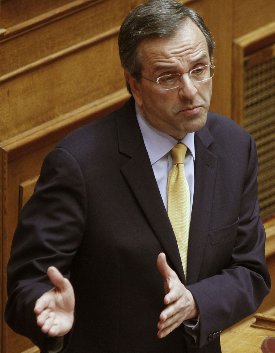 Greek main opposition conservative leader Antonis Samaras addresses the Parliament in Athens on June 19, 2011. (Associated Press)