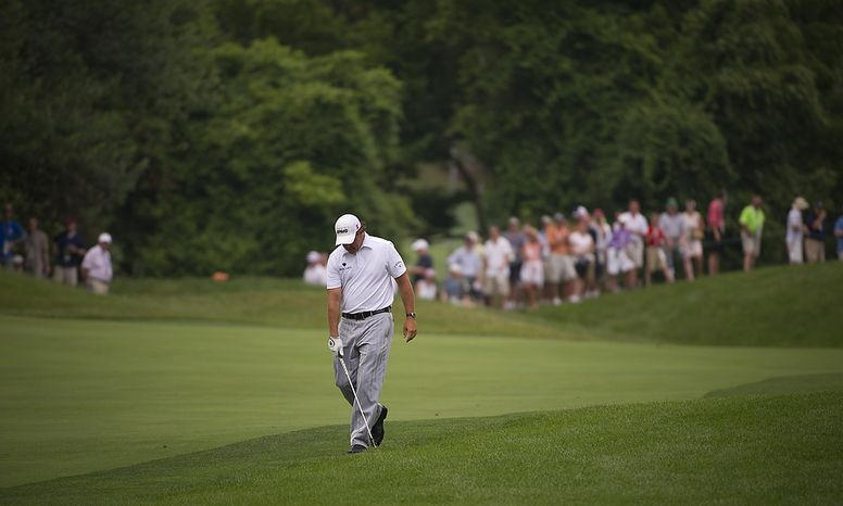 Phil Mickelson reacts after his shot from the sixth fairway during the championship round of the 2011 U.S. Open Congressional, in Bethesda, Md., Sunday, June 19, 2011. (Rod Lamkey Jr./The Washington Times)