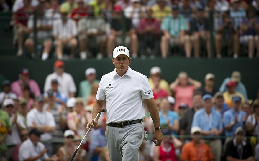Phil Mickelson reacts after his putt on the sixth green as he makes his way to the seventh tee during the championship round of the 2011 U.S. Open Congressional, in Bethesda, Md., Sunday, June 19, 2011. (Rod Lamkey Jr./The Washington Times)