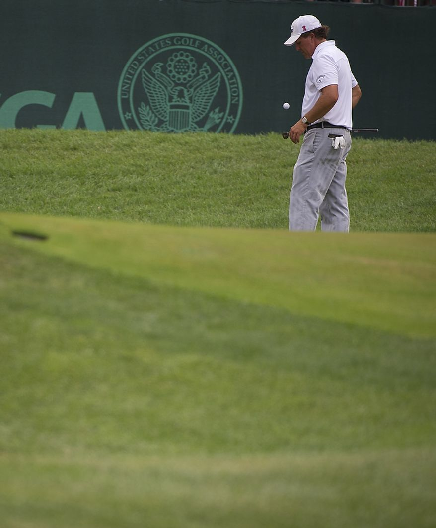 Phil Mickelson waits to putt on the seventh green during the championship round of the 2011 U.S. Open Congressional, in Bethesda, Md., Sunday, June 19, 2011. (Rod Lamkey Jr./The Washington Times)