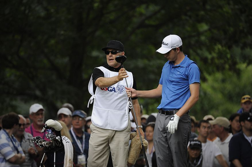 Amateur Patrick Cantlay, USA, is handed his driver by his caddie Dane Jako, his high-school coach, in the tee box of the first hole during the final round of the U.S. Open at Congressional Country Club in Bethesda, Md., Sunday, June 19, 2011. (Drew Angerer/The Washington Times)
