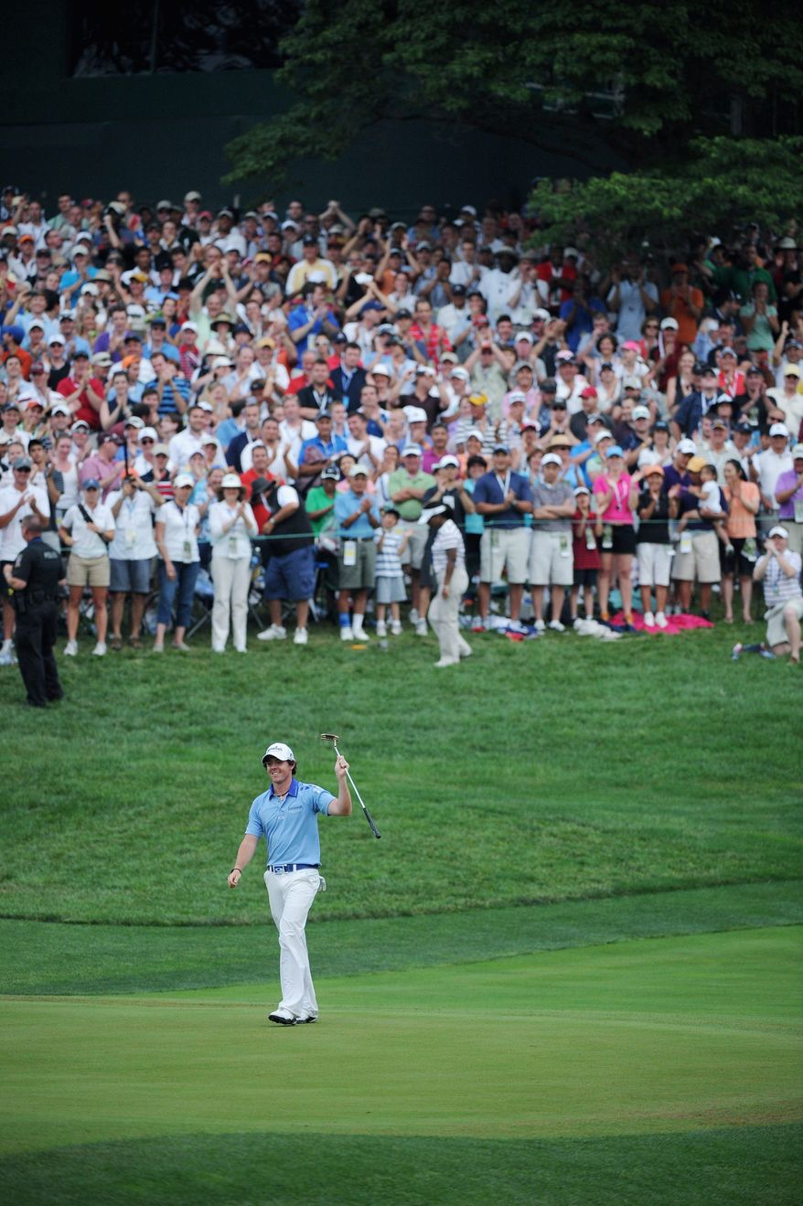 Rory McIlory, of Northern Ireland, acknowledges the gallery after nearly making birdie on the 18th green before finishing -2 for the day and -16 for the tournament to win the U.S. Open championship at Congressional Country Club in Bethesda, Md., Sunday, June 19, 2011. (Rod Lamkey, Jr./The Washington Times)
