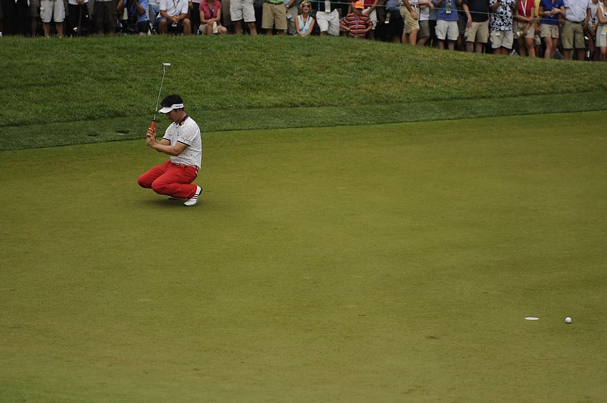 Y.E. Yang, of South Korea, reacts to a missed putt on the third hole during the final round of the U.S. Open at Congressional Country Club in Bethesda, Md., Sunday, June 19, 2011. (Drew Angerer/The Washington Times)