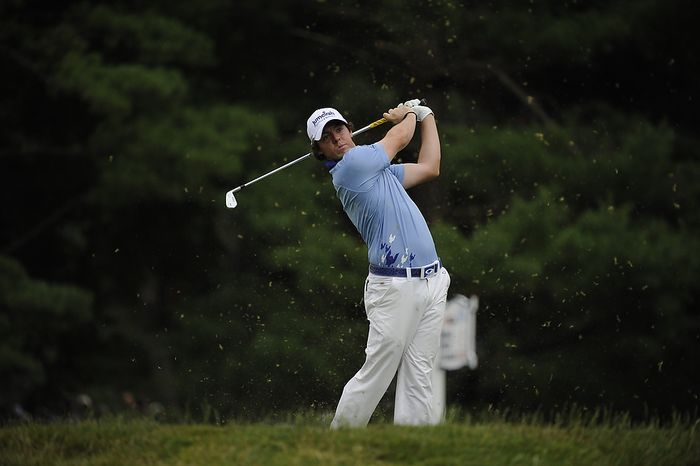 Tournament leader Rory McIlroy, of Northern Ireland, tees off on the par-3 second hole during final round of the U.S. Open at Congressional Country Club in Bethesda, Md., Sunday, June 19, 2011. (Drew Angerer/The Washington Times)