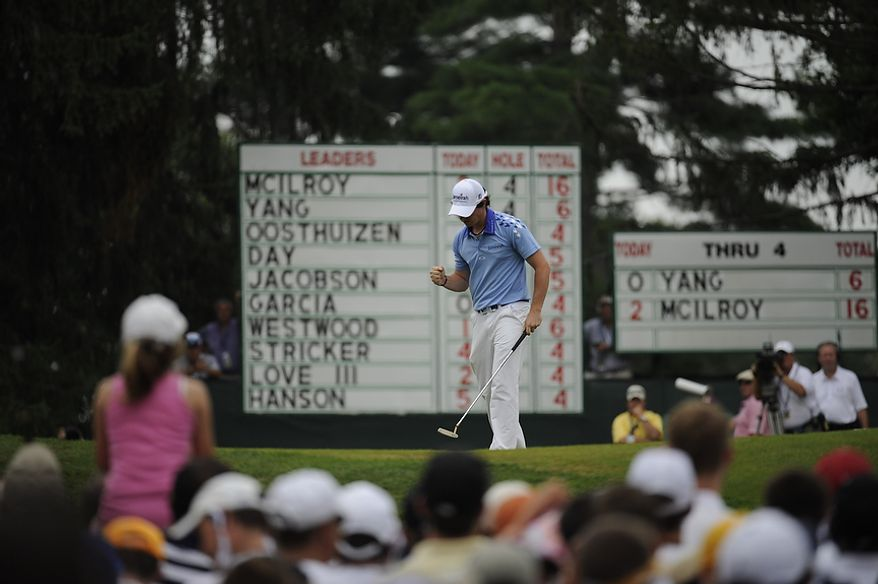 Tournament leader Rory McIlroy, of Northern Ireland, sinks a putt on the fifth hole to save par and stay at 16 under during his final round of the U.S. Open at Congressional Country Club in Bethesda, Md., Sunday, June 19, 2011. (Drew Angerer/The Washington Times)