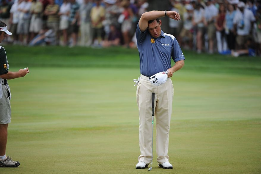 Lee Westwood, of England, wipes his brow before putting on the third hole during his final round of the U.S. Open at Congressional Country Club in Bethesda, Md., Sunday, June 19, 2011. (Rod Lamkey, Jr./The Washington Times)