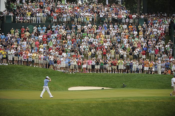 Rory McIlroy, of Northern Ireland, acknowledges the gallery as he walks down the 10th fairway during the final round of the U.S. Open at Congressional Country Club in Bethesda,