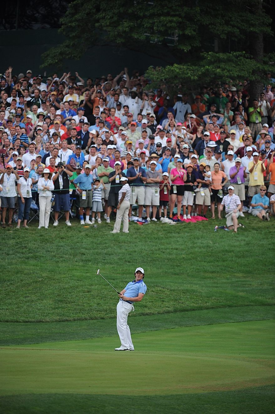 Rory McIlory, of Northern Ireland, reacts after nearly making birdie  on the 18th green before finishing -2 for the day and -16 for the tournament to win the U.S. Open championship at Congressional Country Club in Bethesda, Md., Sunday, June 19, 2011. (Rod Lamkey, Jr./The Washington Times)