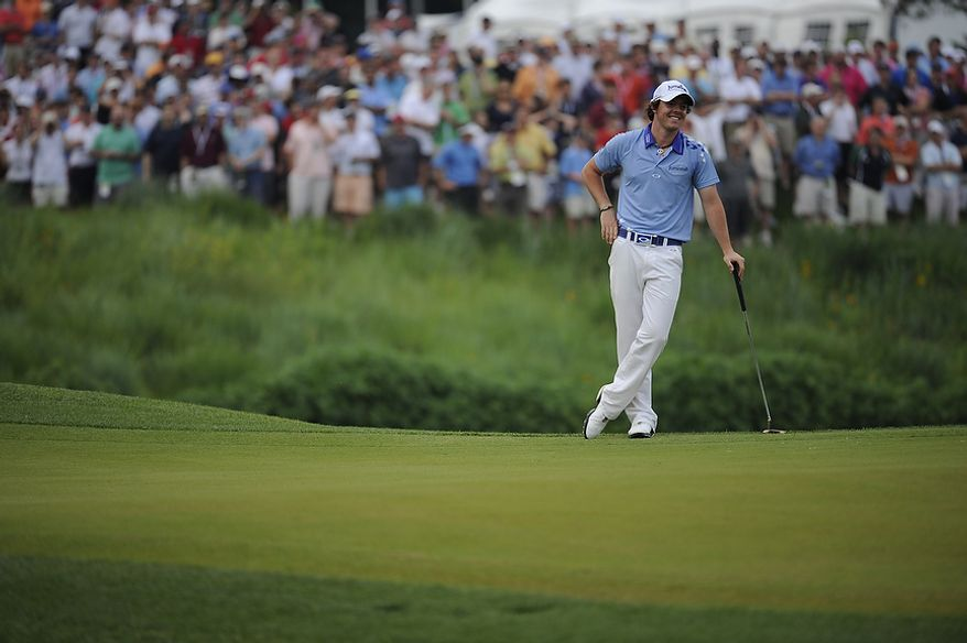 Rory McIlroy, of Northern Ireland, holes a par putt on the 18th green to win the U.S. Open at Congressional Country Club in Bethesda, Md., Sunday, June 19, 2011. (Drew Angerer/The Washington Times)