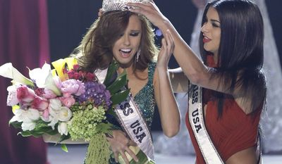 Miss California Alyssa Campanella is crowned as the 2011 Miss USA by Miss USA 2010 Rima Fakih on Sunday, June 19, 2011, in Las Vegas. (AP Photo/Julie Jacobson)