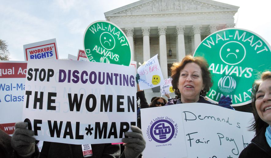 Carol Rosenblatt (right), of the District, takes part in a rally at the Supreme Court on March 29 in support of plaintiffs in a case of female employees against Wal-Mart.  The National Women's Law Center decried Monday's ruling, which held there were too many female plaintiffs in too many different jobs to justify a class-action lawsuit. (Associated Press)